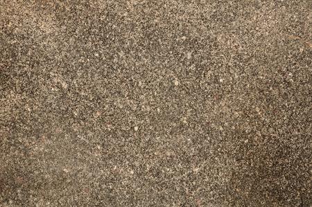 Roughened texture of gray granite wall photo