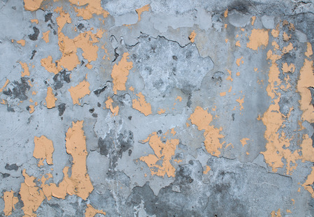 Texture of old crumbling wall with remnants of yellow plaster Stock Photo