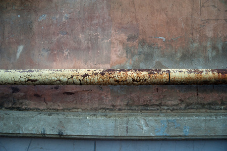 crack pipe: Texture of old gray cement wall with rusty drain pipe Stock Photo