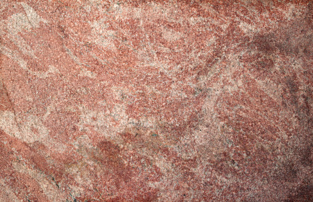 Texture of old wall of polished pink granite photo