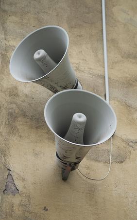 loudspeaker: Loudspeaker on wall old yellow building