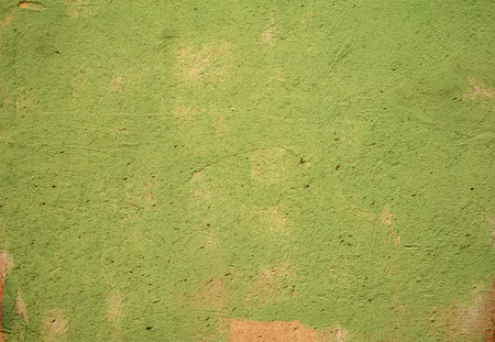 Texture of old rustic wall covered with green stucco photo