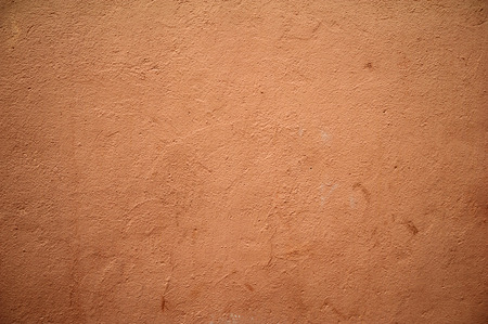 rusty background: Texture of old rustic wall covered with brown stucco