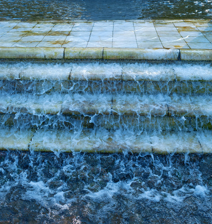 trickle down: Water flows down old marble steps Stock Photo