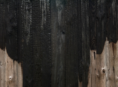 charred: Charred wooden house wall after fire Stock Photo