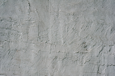 stucco texture: Texture of old rustic wall covered with gray stucco Stock Photo