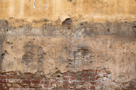 stucco texture: Texture of old rustic wall covered with yellow stucco