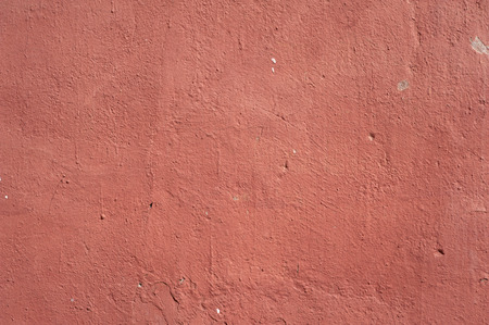 stucco texture: Texture of old rustic wall covered with pink stucco