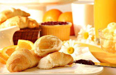 Fresh croissants with butter, strawberry jam and orange juice. Stock Photo - 2523010