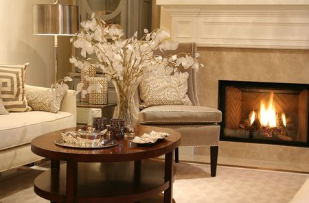livingroom: Elegant living room with fireplace on.