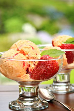 Summertime! Mango or peach icecream with strawberries.