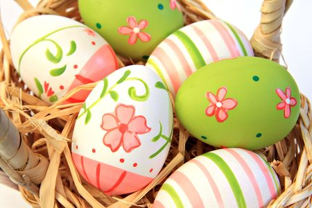 Hand painted easter eggs. Shallow depth of field, focus on the two main front eggs.  photo