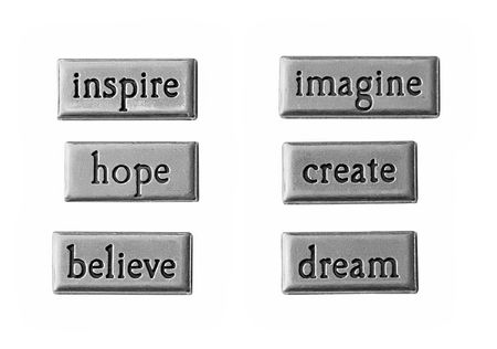 believe: Word of inspiration on stainless steel.  Stock Photo