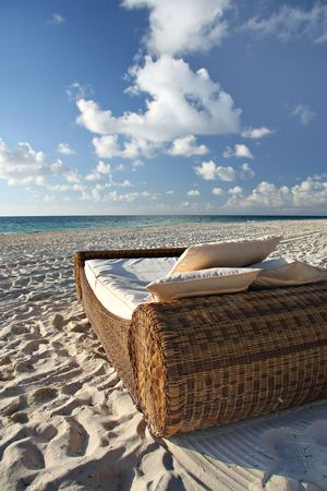 Beautiful bed on deserted tropical beach.