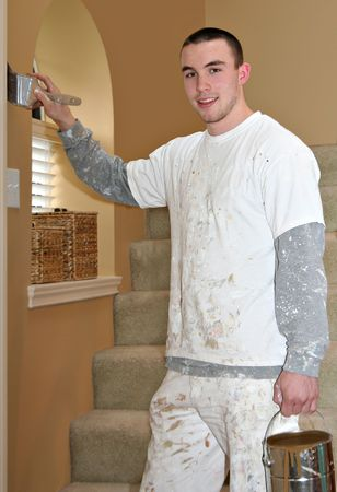 house coats: Handsome young student painter at work.  Stock Photo
