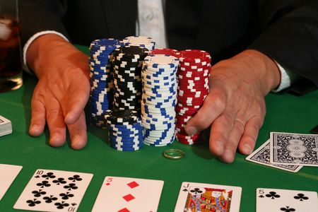 all in: All in! Man pushes in all his chips and his gold  ring.  Editorial