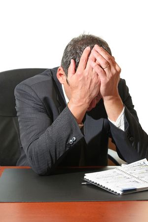 preoccupation: Frustrated business man hold his head in his hands.