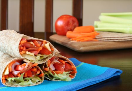 Healthy lunch, ham, cheese and vegetables wrapped in whole wheat tacos. Stock Photo - 3199342