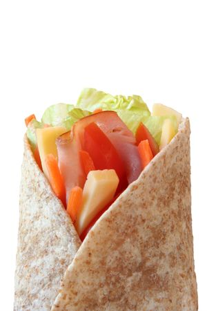 ham and cheese: Healthy lunch, ham, cheese and vegetables wrapped in a whole wheat tortilla.