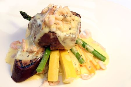 entree: Beautiful beef tenderloin entree with potatoes, vegetables and bearnaise sauce.