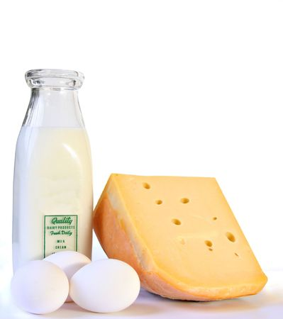 Milk, cheese and eggs, isolated on white.
