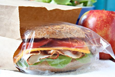 Whole grain sandwich in a lunch bag.