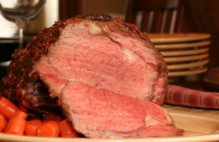Prime rib roast beef, cooked medium.  Stock Photo