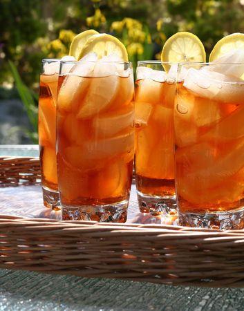 Glasses of refreshing lemon ice tea, outside in the summertime.  Stock Photo