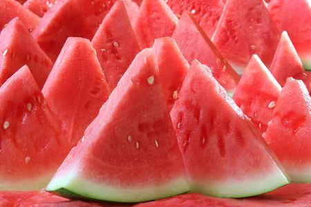 Background of brightly lit watermelon slices.  Stock Photo