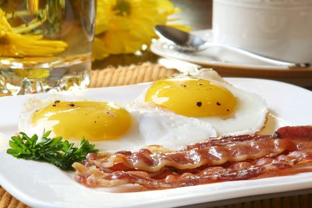 sunnyside: Bacon and eggs, sunny side up.