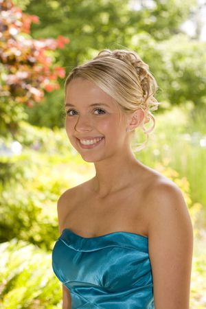 prom dress: Beautiful teenage girl, dressed up for the prom.  Stock Photo