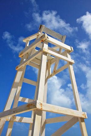 lifeguard tower: Old wooden lifeguard tower on a beach.  Stock Photo