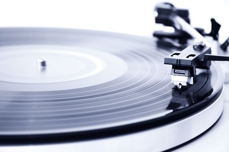 bpm: Spinning record player. Focus on the needle head.