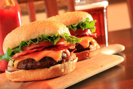 Juicy bacon cheeseburgers and beer. Stock Photo - 3331906