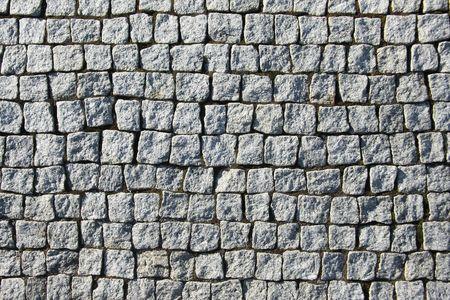 square: Old grey square brick wall.