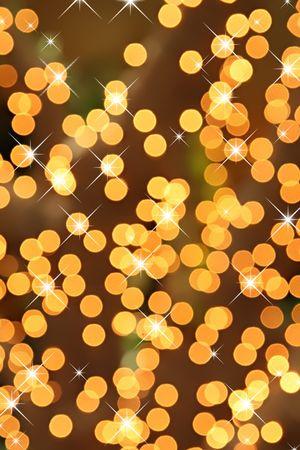 festive: Sparkling festive background of golden Christmas lights.
