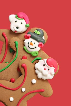 gingerbreadman: Gingerbread men cookies on red. Stock Photo