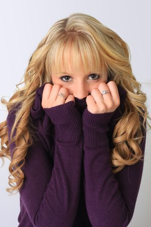 Cute blond girl hiding her face.  Stock Photo