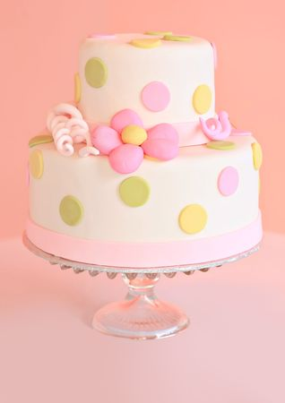 cake with icing: Beautiful pink wedding cake, shallow dof, focus on center of the cake.  Stock Photo