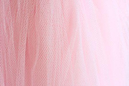 Feminine pink fabric background. photo