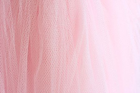 Feminine pink fabric background. Archivio Fotografico