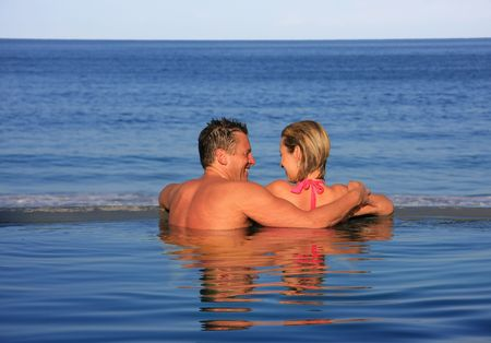Happy couple in the swimming pool.  photo