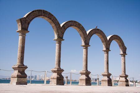 roman pillar: Puerto Vallarta arches on the Malecon. Stock Photo
