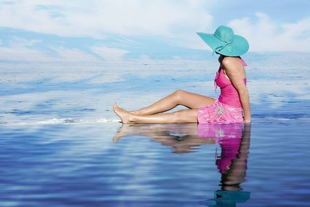 Woman on vacation, relaxing by the pool. Stock Photo - 4656834