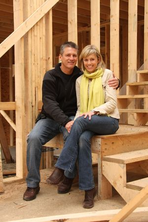 Happy couple inside their new home still under construction.  photo