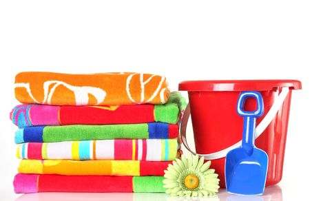 Summer beach towels with bucket and shovel.