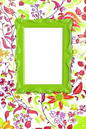 Pretty green picture frame hanging on floral wallpaper. Stock Photo - 4870561