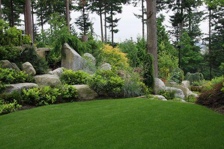 garden landscape: Beautiful garden in summer.  Stock Photo