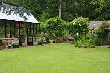 upscale: Beautiful greenhouse in an upscale garden.  Stock Photo
