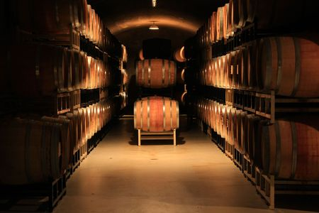wineries: Wine barrels stacked in a cellar. Also available in vertical.